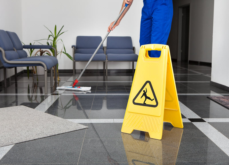 Day porter services - mopping entry floor